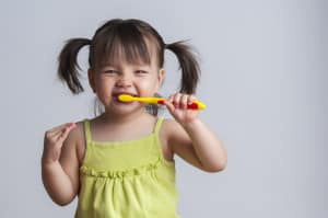 get child to brush their teeth