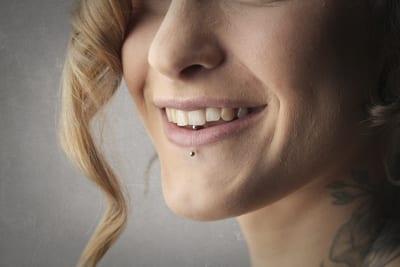 tongue and lip piercings teeth